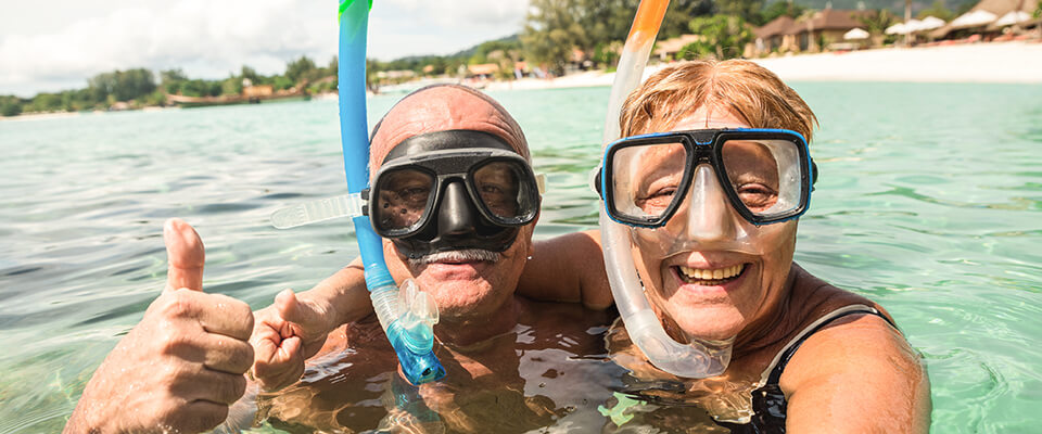 Senior-couple-enjoying-vacations-with-reverse-mortgage